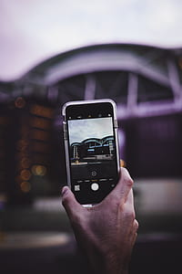 shallow focus photography of iPhone camera capturing grey building
