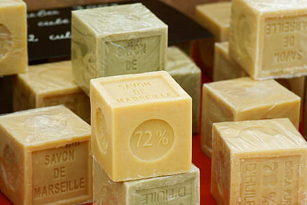photography of brown and green soaps