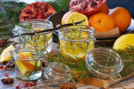 sliced lemon in clear glass jars