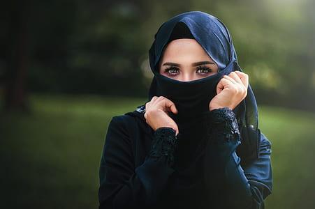 woman wears black abaya dress