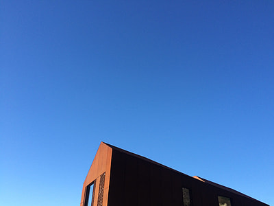 brown wall house under blue sky