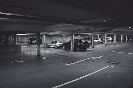 grayscale photography of parked cars