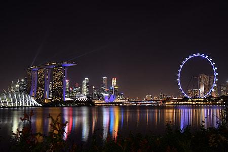 three assorted landmarks photo during nighttime