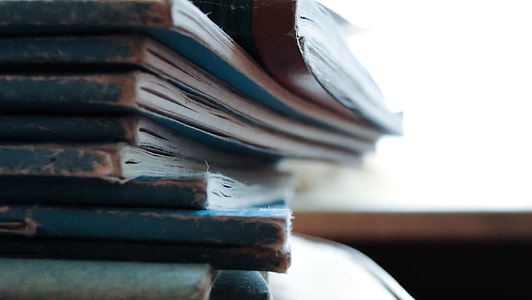 close up photo of blue and white books