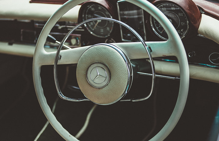 image contains close up photo of Mercedez Benz car steering wheel