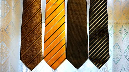 four assorted-color neckties