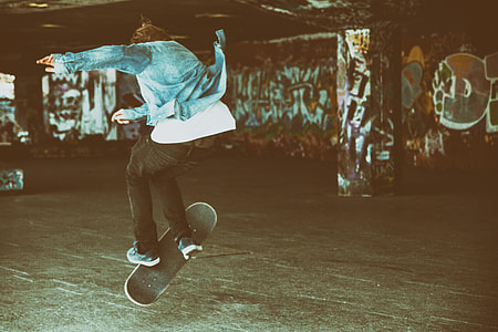A skateboarder makes a jump at the Southbank by the River Thames in London, England