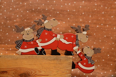 four Christmas deers on brown wooden board decors