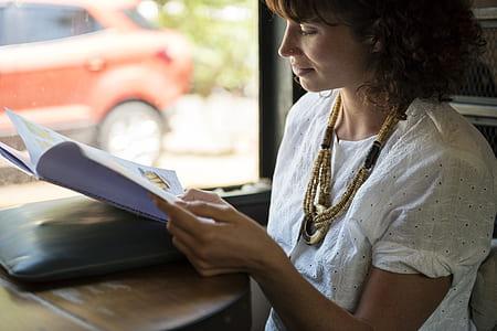 woman wearing white scoop-neck t-shirt