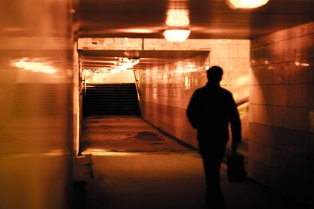 man walking inside subway