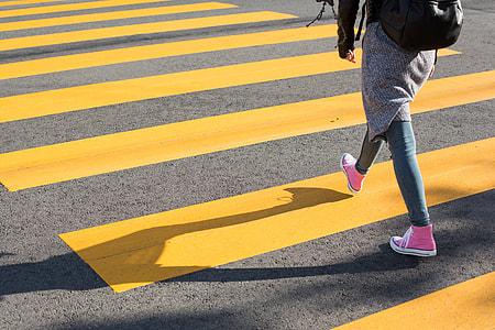 Girl Crossing Street on a Yellow Crosswalk