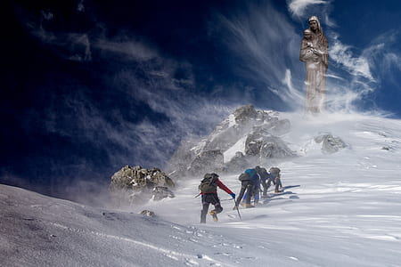 group of people hiking on snow mountain