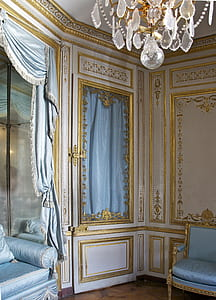 white and gold wooden door