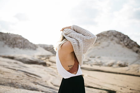Women Taking Off knitted sweater