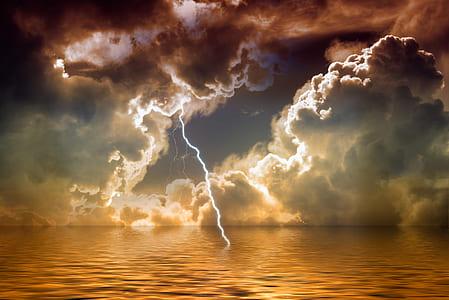 photo of lightning hitting body of water