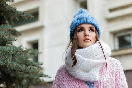 woman wearing white knitted scarf and pink cardigan
