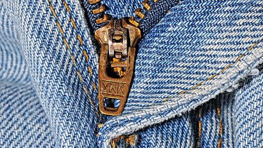brass zipper and blue denim bottoms