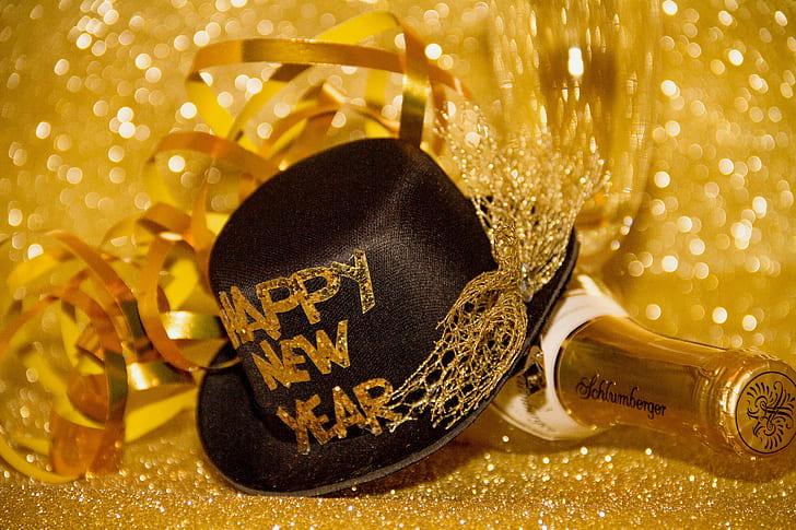 black hat over bottle with gold backgrund