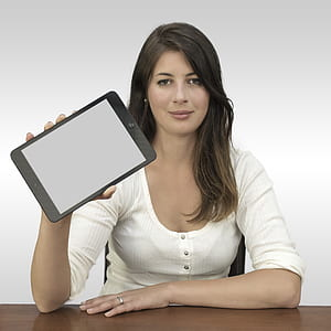 photo of woman holding black tablet computer