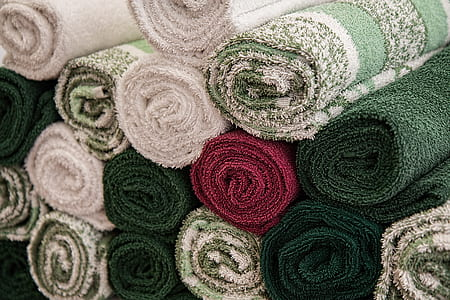 close-up photo of assorted-color rolled rug lot