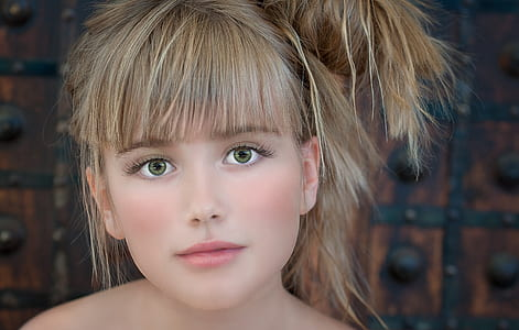 closeup photo of blonde haired woman's face