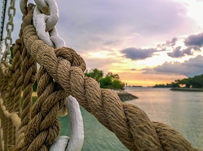 brown rope and white metal chain