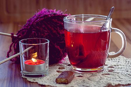 turkish mug beside tealight candle holder and purple yarn