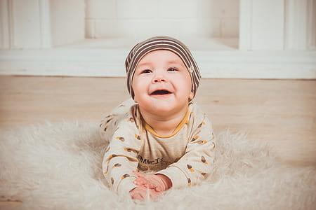 baby in brown onesie