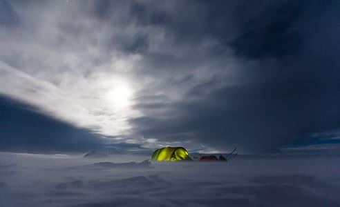 photo of green tent on snowfield