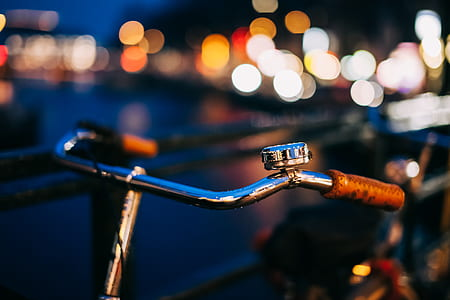 selective-focus photography of silver bicycle handle