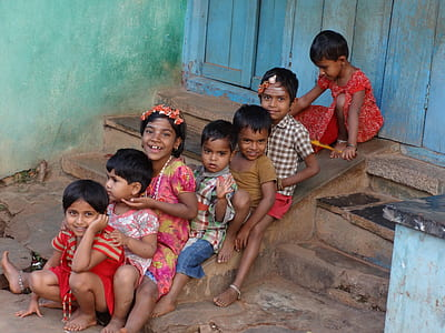seven children on concrete staircase