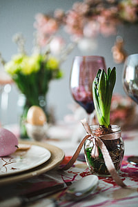 Easter table with cute pink decorations, flowers, catkins and eggs