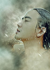 man's face with water