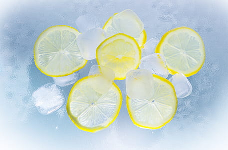 Sliced Lemon on Ice Water