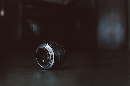focused close-up photo of black and gray camera lens