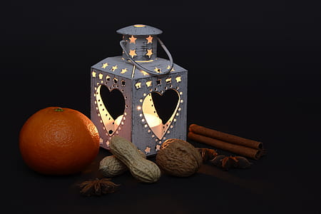 photo of lantern beside orange and peanuts