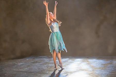 woman wearing blue dress screenshot