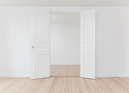 opened white wooden 3-panel door