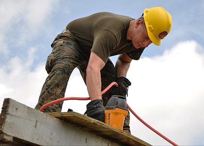 man in yellow construction helmet