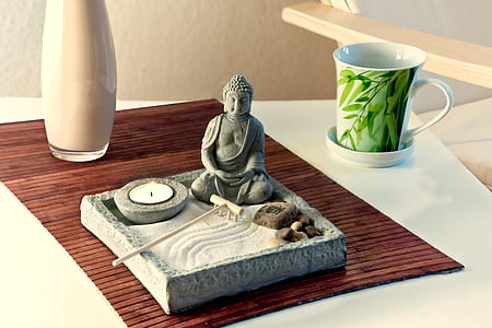 Buddha ceramic figurine on tray