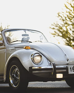 photo of white Volkswagen convertible Beetle