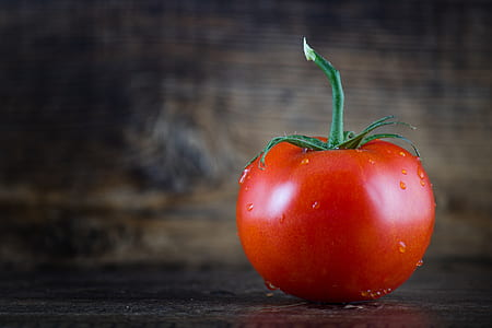 close-up photo of tomato with water droplets