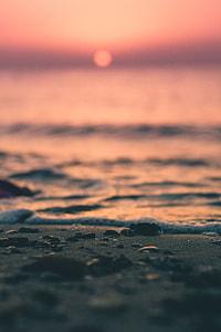 water, foam, sand, sunset