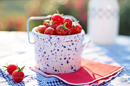 cherry tomatoes on white and blue ceramic container