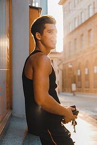 man wearing black tank top