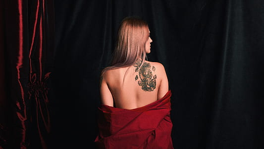 women's red top with tattoo on her back