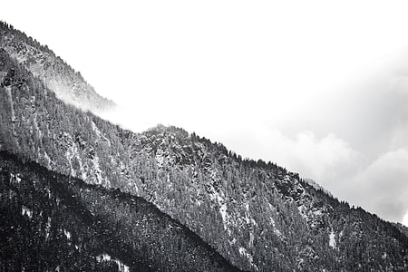gray scale mountain range photo shot during daytime