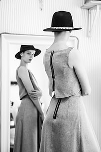 woman standing on front of mirror