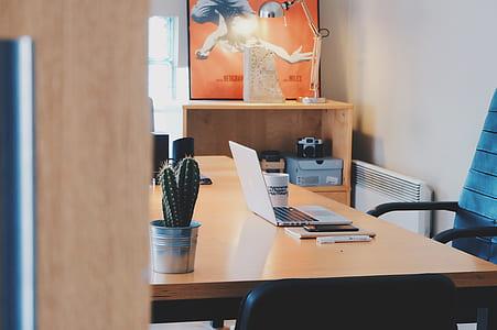 white laptop computer on wooden desk