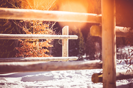 Wooden Fence on Mountain Path in Winter